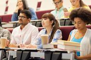 Group of students with notebooks on lecture Stock Photos
