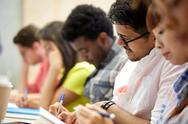 Group of international students writing at lecture Stock Photos