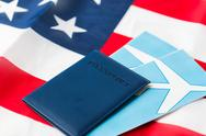 American flag, passport and air tickets Stock Photos