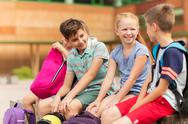 Group of happy elementary school students talking Stock Photos