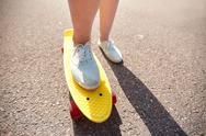 Close up of female feet riding short skateboard Stock Photos