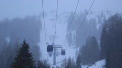 The gondola lift on a snow covered mountain resort. Stock Footage