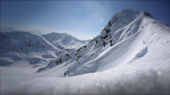 A man skiing down from the top of a snow covered mountain. Stock Footage