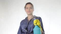 Young housewife washed window with a spray, cloth and detergent. Large glass in Stock Footage