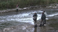 Fishermen at a river fishing for salmon in the fall  Stock Footage