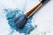Blue shadows with brush piled on white background Stock Photos