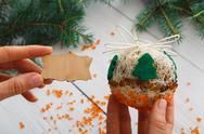 Creative diy hobby. Handmade craft christmas decoration ball with tree Stock Photos
