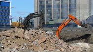 Heavy construction machinery working on the construction of the highway. Stock Footage