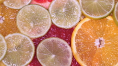 Vitamin citrus fruits lemon, orange, lime, pomelo, grapefruit rotating Stock Footage