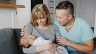 Young family with a child two months. Father, mother and son Stock Footage