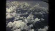 1962: view from airplane window looking out at clouds below SAN PEDRO Stock Footage