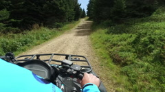 Scenic fast ride on atv quad four wheeler bike mountain road off road POV Stock Footage