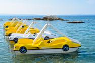 Sea peddle boats on the water surface Stock Photos