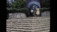 1962: group of people go up the steps to enter beautiful tall building.  Stock Footage