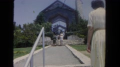 1962: woman walking into church SAN PEDRO, CALIFORNIA Stock Footage
