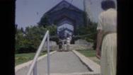 1962: woman walking into church SAN PEDRO, CALIFORNIA Stock Footage
