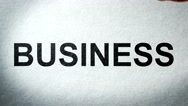 The Words Business on paper Burning in Flames to Ashes Stock Footage