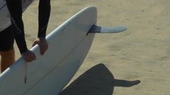 The shadow of a longboard surfboard and its fin on the beach. Stock Footage