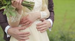 A groom hugging his bride. No faces Stock Footage