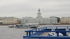 The river Neva quay, St Petersburg. A river bus floating on it, beautiful city Stock Footage