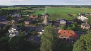 Aerial circling windmill in village,Ottersum,Netherlands Stock Footage