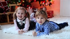 Happy Cute little boy and his beautiful sister at Christmas, children laughing Stock Footage
