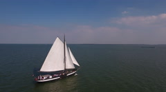 Historic Dutch sailboat with party at sea. Aerial. Stock Footage