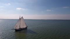 Historic Dutch sailboat at sea. Aerial. Stock Footage