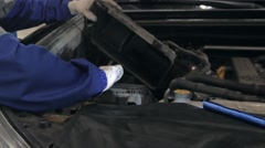 Mechanic checking oil level in a car workshop. Man in truck service checking Stock Footage