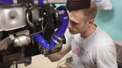 Experienced mechanic inspect the car engine Stock Footage