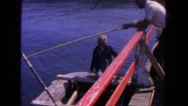 1962: mooring the boat in the harbor for lunch in the city and relax bit more. Stock Footage