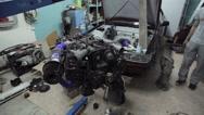 Car engine in a car workshop Stock Footage