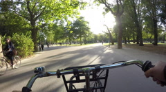Riding a bicycle in park Amsterdam. Stock Footage