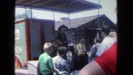 1962: man plays guitar to group of people at festival SAN PEDRO, CALIFORNIA Stock Footage