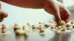 Close up of a preparing an eastern meal with dough in a kitchen. Stock Footage