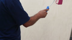Human hand painting with roller in hand. Stock Footage