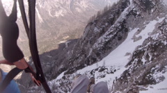 A man is speed flying riding above the snowy mountains. Stock Footage