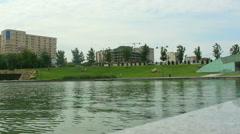 Lake and city. Cars crossing. Baku Azerbaijan Stock Footage