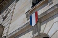 French flag waving over one Hotel de Ville Stock Photos