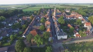 Aerial approaching church in beautiful walled city,Buren,Netherlands Stock Footage
