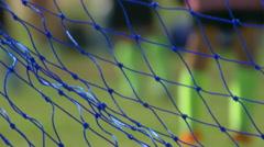A soccer game through a soccer football goal net. Stock Footage