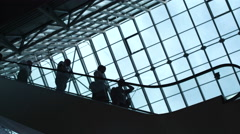 People move on an escalator in a building Stock Footage