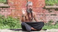 Portrait of colorful sadhu, holy man in Pashupatinath Temple, Kathmandu, Nepal Stock Footage