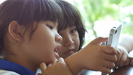 4K : Close up of Asian child playing game on smart phone together Stock Footage