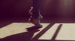 Girl in jeans and sneakers runs on the concrete floor Stock Footage