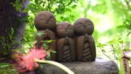 Cute stone monk statue Jizo Statue Stock Footage