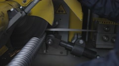 Industrial milling saw cuts the tube with sparks Stock Footage