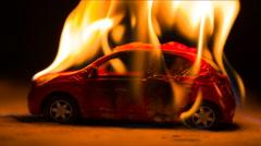 Burning car at night Stock Footage