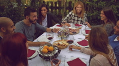 Group of friends enjoying together at a dinner party Stock Footage