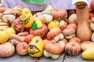 Pile of pumpkins drawn as monsters at harvest Stock Photos